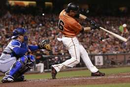 Giants' Angel Pagan hits a RBI sacrafice fly in the first inning to score Brandon Belt, as the an Francisco Giants take on the Los Angeles Dodgers at AT&T Park  in San Francisco , California on Fri. Sept. 30, 2016.