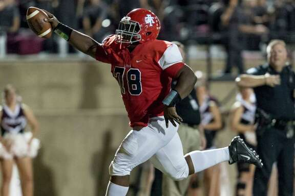 Alief Taylor defensive end Kobie Whiteside celebrates as he returns an interception 21 yards for a touchdown against Pearland.