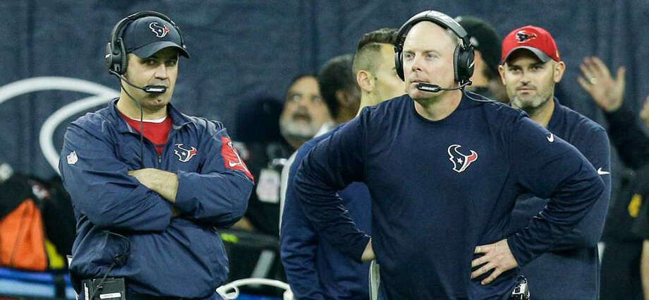 Longtime aide George Godsey, right, was a casualty after the Texans put up historically inept offensive numbers for a playoff team. O'Brien will take over offensive coordinator duties with Godsey gone. Photo: Brett Coomer/Houston Chronicle