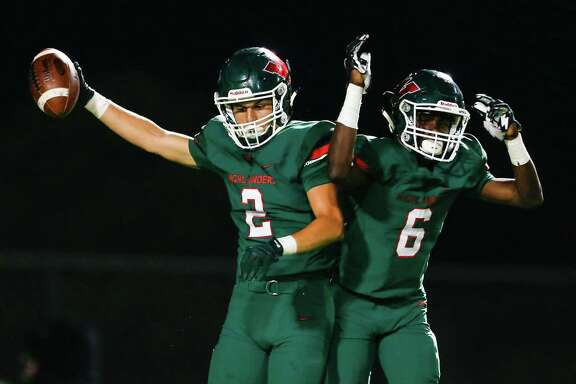The Woodlands receiver Dylan Casey (2) and Kesean Carter (6) celebrate Casey's 49-yard touchdown reception against Lufkin during the first quarter of a District 12-6A football game at Woodforest Bank Stadium on Friday, Sept. 30, 2016, in Houston. ( Brett Coomer / Houston Chronicle )