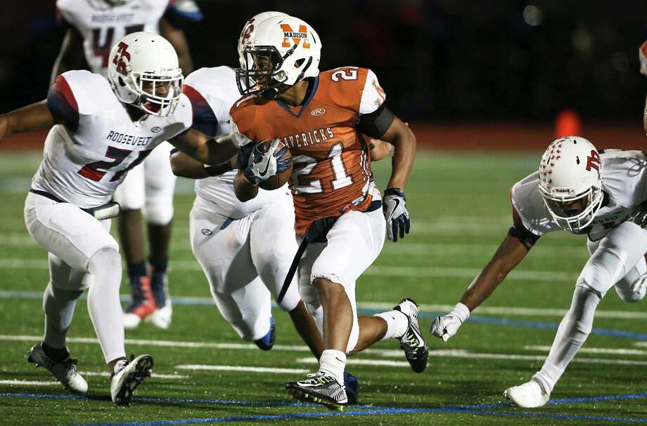 Mavericks running back Nate Davis eludes tacklers in the first half as Roosevelt plays Madison at Heroes Stadium on Sept. 30, 2016. Photo: Tom Reel /San Antonio Express-News / 2016 SAN ANTONIO EXPRESS-NEWS