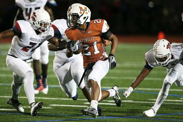 Maverick running back Nate Davis eludes tacklers in the first half as Roosevelt plays Madison at Heroes Stadium  on September 30, 2016.