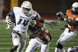 Roosevelt's LeRoy Giles flashes to the outside, breaking the tackle of Santino Campos, then running in for a touchdown in the first half against Madison at Heroes Stadium on Sept. 30, 2016.