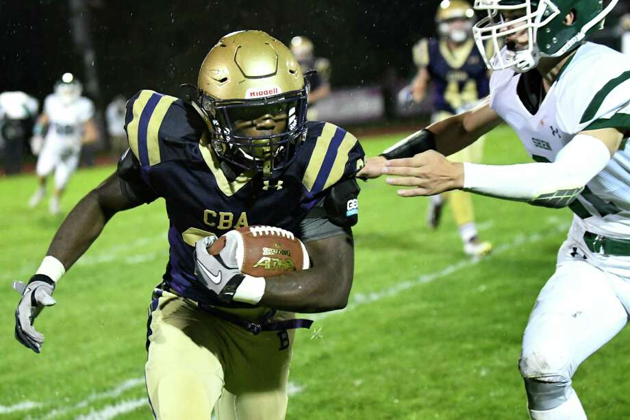 CBA's Taurian Taylor, left, carries the ball during their football game against Shenendehowa on Friday, Sept. 30, 2016, at Christian Brothers Academy in Colonie, N.Y. (Cindy Schultz / Times Union) Photo: Cindy Schultz / Albany Times Union