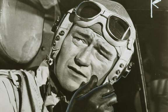 "Wayne25_03 John Wayne in ""Flying Leathernecks.""  Publicity photo, ""Copyright 1951."""