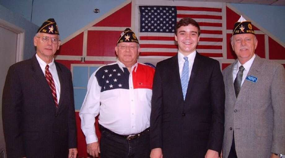 """The Dayton American Legion Post 512 members congratulated Liberty High School Student Drew Dugger for winning first place in the High School Oratorical Scholarship Contest. Shown from left to right are Dennis """"Mike"""" Key, Jerry Killion, Drew Dugger and Mark McClelland."""