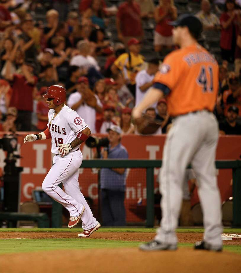 Sept. 29: Angels 7, Astros 1Los Angeles Angels' Jefry Marte, left, runs the bases after hitting a solo home run off Houston Astros starting pitcher Brad Peacock, right, during the third inning of a baseball game in Anaheim, Calif., Friday, Sept. 30, 2016. (AP Photo/Kelvin Kuo) Photo: Kelvin Kuo, Associated Press / FR170752 AP