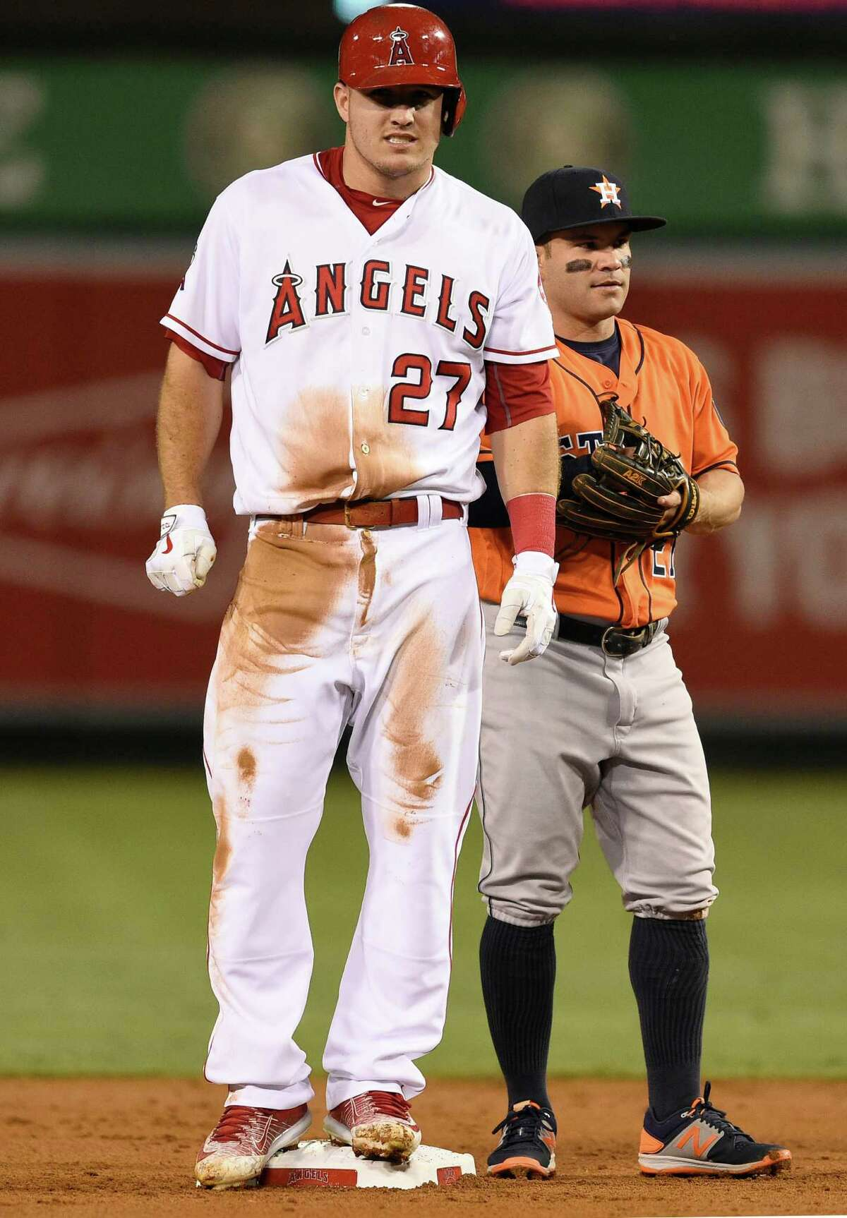 Los Angeles Angels' Mike Trout, left, stands on second after stealing the base as Houston Astros second baseman Jose Altuve, right, looks on during the first inning of a baseball game in Anaheim, Calif., Friday, Sept. 30, 2016. (AP Photo/Kelvin Kuo)