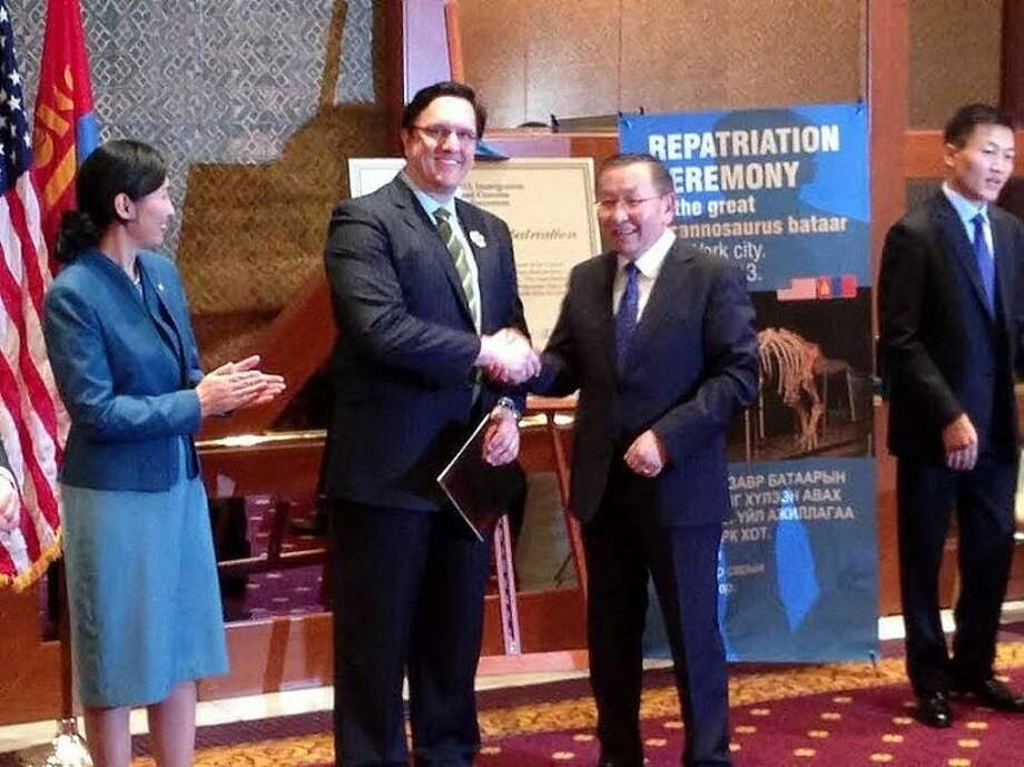 President Elbegdorj bestows the Order of the Polar Star inrecognition of Robert Painter's successful representation of the President and Government of Mongolia that led to the repatriation the great Tyrannosaurus bataar fossil, which had been illegally smuggled out of the country.