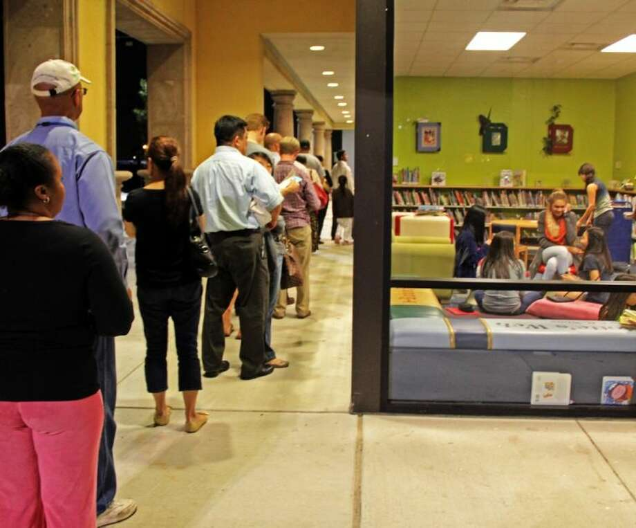 West Pearland residents lined up outside the west Pearland Library to vote in the school bond election for the Alvin Independent School District. Photo: KRISTI NIX