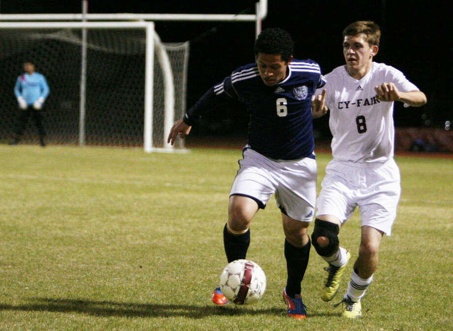 Cy-Ridge's Franklin Lemus battles against Cy-Fair's Morgan Shay during Thursday night's game at Cy-Fair High School.