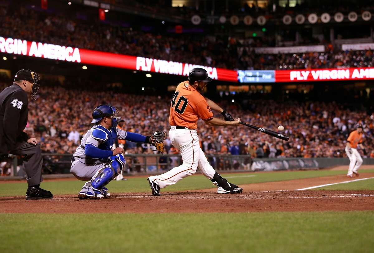 Giants' Madison Bumgarner hits a double in the 6th inning to score two runs, as the an Francisco Giants take on the Los Angeles Dodgers at AT&T Park in San Francisco , California on Fri. Sept. 30, 2016.