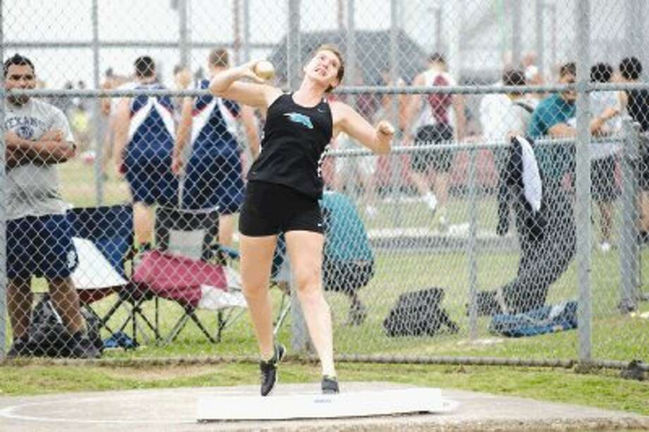 """Kati Gunn prepares to hurl """"Charlie,"""" during last week's District 22-5A shot put competition. Gunn and Charlie will be back in action this afternoon as the college-bound Gunn bids for a Region III berth in both the shot and discus. / © 2012 Kirk Sides/Houston Community Newspapers"""