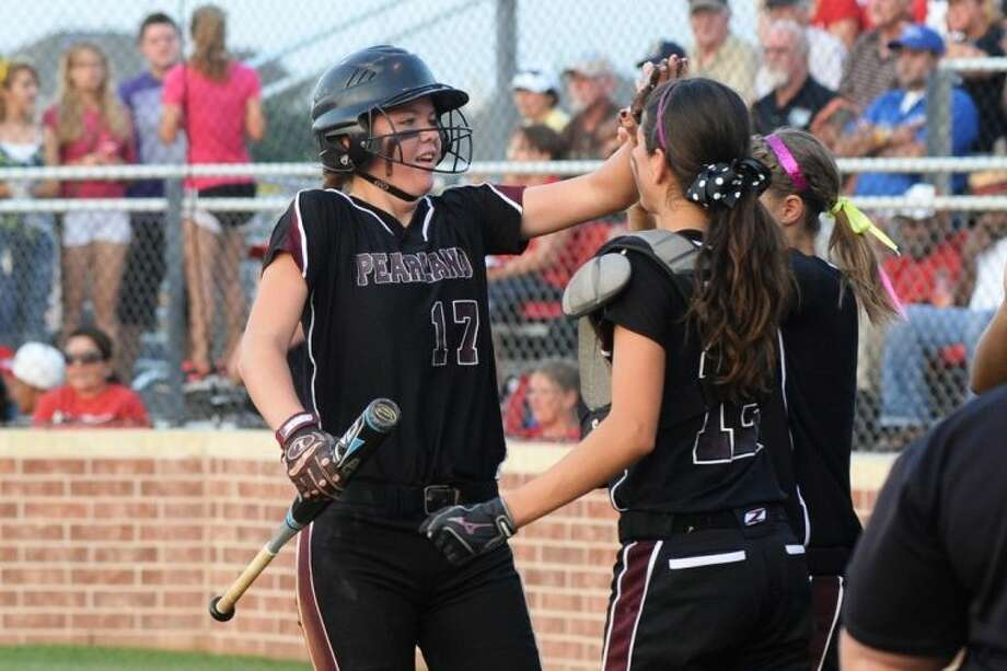 Pearland junior shortstop Kristen Cuyos (left) says the Lady Oilers need to show more heart to reach their full potential this season.