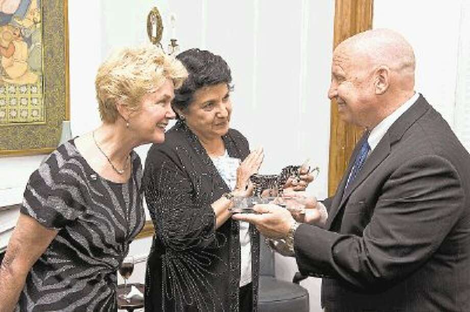U.S. Rep. Kevin Brady, R-The Woodlands, receives an award from Carol Ann Demaret, center, mother of David Vetter, and Immune Deficiency Foundation President Marcia Boyle at an event celebrating the Medicare IVIG Access Act in Washington, D.C. / 2013 RISDON PHOTOGRAPHY