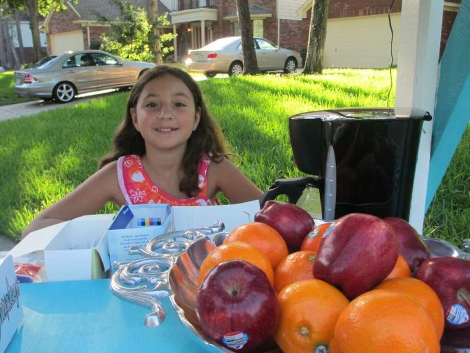 """Mills Branch resident Angela Santeiro opened the """"Mills Branch Café"""" this summer in her neighborhood where she could sell breakfast items in the morning and homemade snacks in the afternoon to learn about business and raise some money."""
