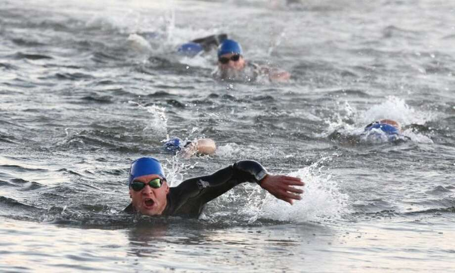 Swimmers compete in the 500-meter swim in the first leg of the Katy Triathlon at Firethorne on October 28, 2012. The event returns to Firethorne Sept. 29 for its 21st year.