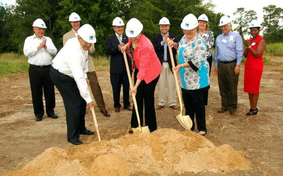 Chuck Turet (front, left), former TIRZ 17 chairman; Helena Brown, District A council member; and Ann Thomas Givens, TIRZ 17 chairman, turn the first shovels of dirt Friday at the groundbreaking ceremony for TIRZ 17's detention basin. Watching (from left) are Bob Tucker, TIRZ 17 board member; Glenn Airola, TIRZ 17 board member; Zachary Hodges, TIRZ 17 board member; state Rep. Dwayne Bohac; Brenda Stardig, former TIRZ 17 board member; Ken Arnold, former TIRZ 17 board member; and Gwen Tillotson, deputy director of economic development for the city of Houston.