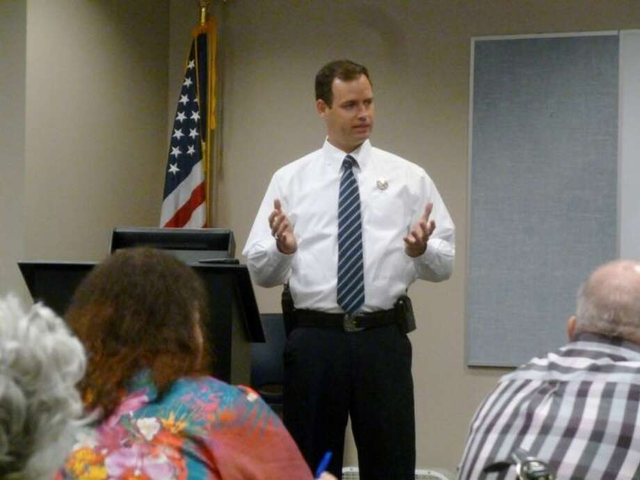 Klein Oak graduate Lt. Jason Taylor of the Texas Rangers gives a presentation to chamber members about his agency Sept. 19.