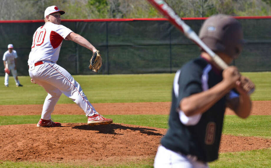 Tyler Davenport winds up to throw a pitch to Rene Purcell during a baseball game between Crosby and Summer Creek on March 12, 2013, at Crosby High School. Davenport had 14 strikeouts in the Cougars' 3-1 win.