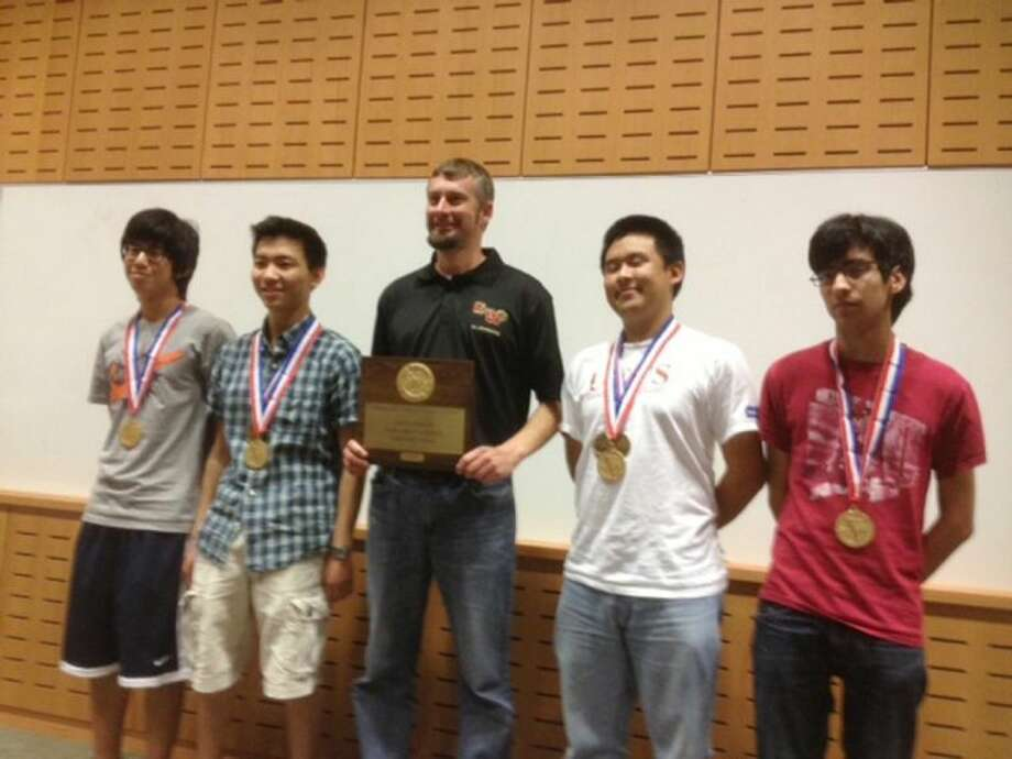 The Cypress Woods High School computer science team, comprised of, from left, Luke Tseng, Andrew Liu, sponsor Stacey Armstrong, Ben Lin and Nikoli Cartagena, won the state championship at the UIL Class 5A Academics Spring Meet.