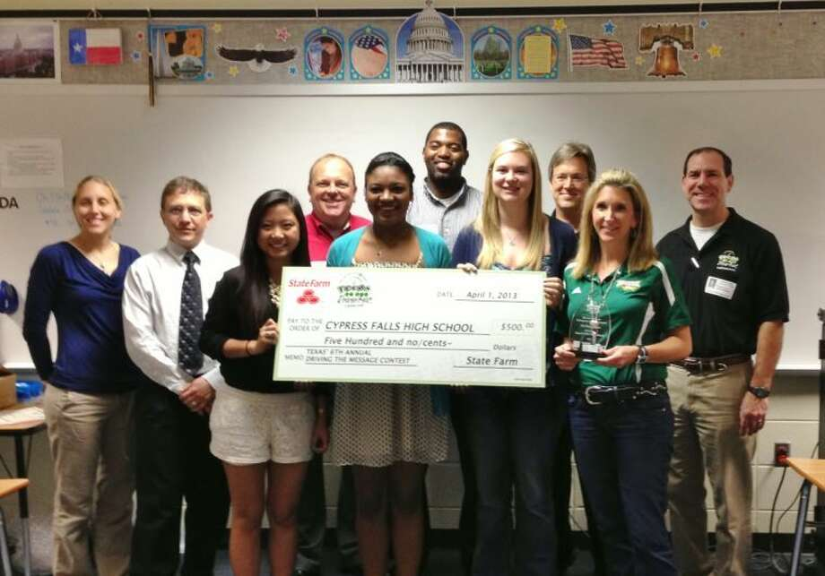 Local State Farm agent David Everest, and Director Russell Henk from Teens in the Driver Seat present a $500 check to Cy-Falls students Kimberly Van, Marissa Cummings, Paige Baker, and Lauren Gourgues, Friday morning, April 12.