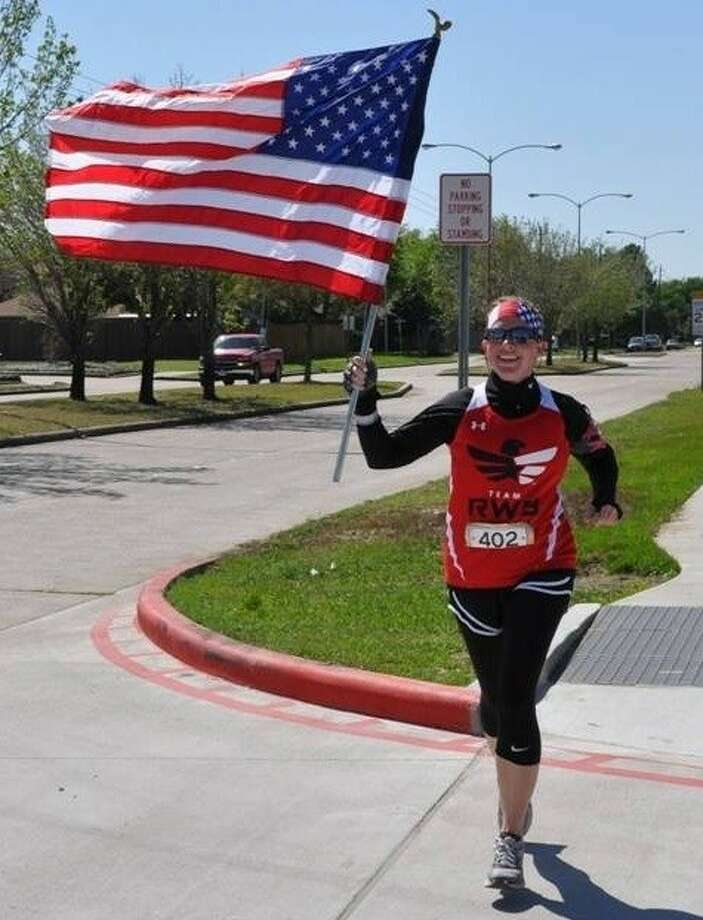 Air Force Veteran Allison Lanier carried a flag with her for part of the 200-mile Texas Independence Relay.