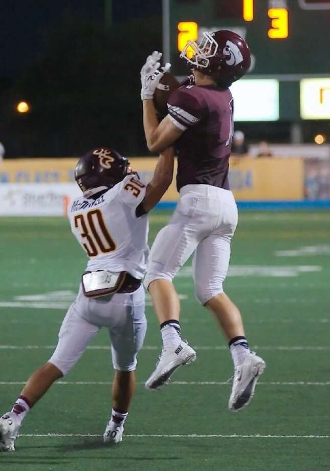 Clear Creek's Landon Etzel (11) jumps high to make the catch over Deer Park's Terry McDowell (30) in a recent game. The Deer defense showed improvement in the district opener, looking for further upgrade this week.