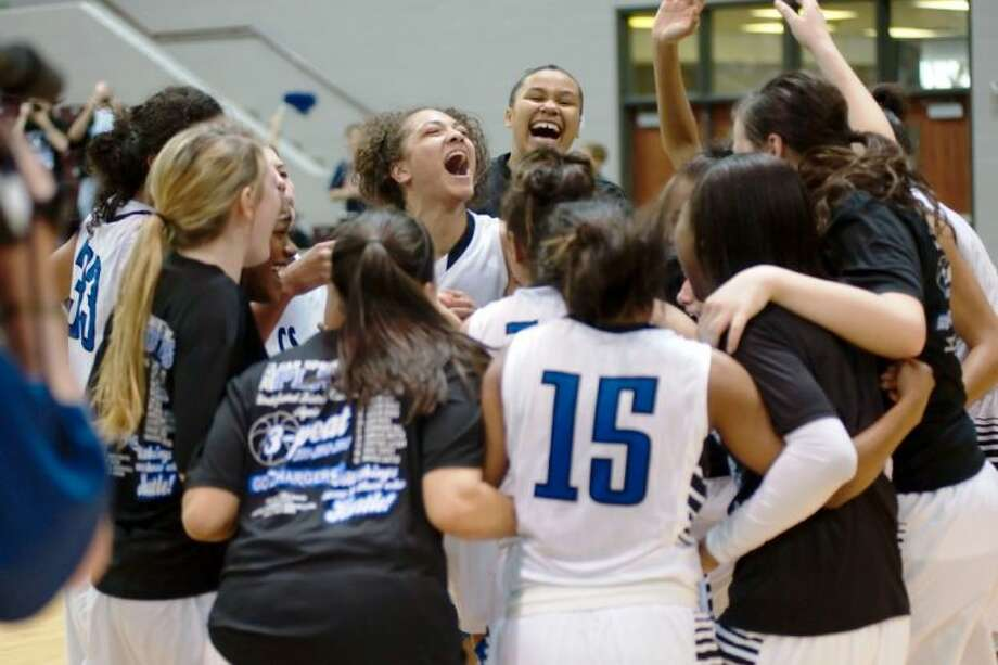 Clear Springs players celebrate their 55-44 win over Katy Seven Lakes Saturday that earns the Lady Chargers a spot in next week's girls' state basketball tournament in Austin.