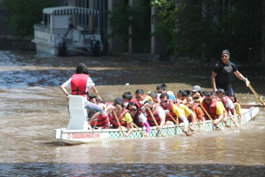 Teams compete at the 13th annual Houston Dragon Boat Festival on Saturday at Allen's Landing.