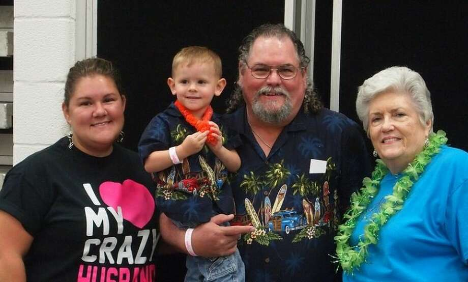"""Four generations of the Perry family have helped the annual Shrimp Boil take on the feel of a """"family reunion."""" Crystal Fox of Cleveland (far left) assisted her grandmother Helen Perry of Houston (far right) with the first-ever Shrimp Boil. Bradley Perry of Shepherd is holding Cameron Fox to complete the photo captured at the 24th Annual fundraiser for The Rose."""