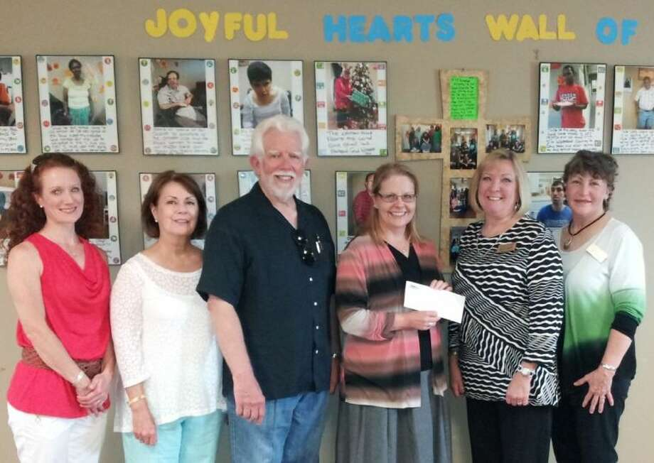 Members of the Lowrey family and staff of the Community Foundation of Brazoria County visit Forgotten Angels and present a check for $20,000 to assist in enlarging its DayHab facility. Pictured left to right are: Jennifer Wehrly, Leslie Lowrey, Mike Lowrey, Holly McDonald of Forgotten Angels, Barbara Franklin, Executive Director of the Community Foundation of Brazoria County and Abby Bundick of the Community Foundation.