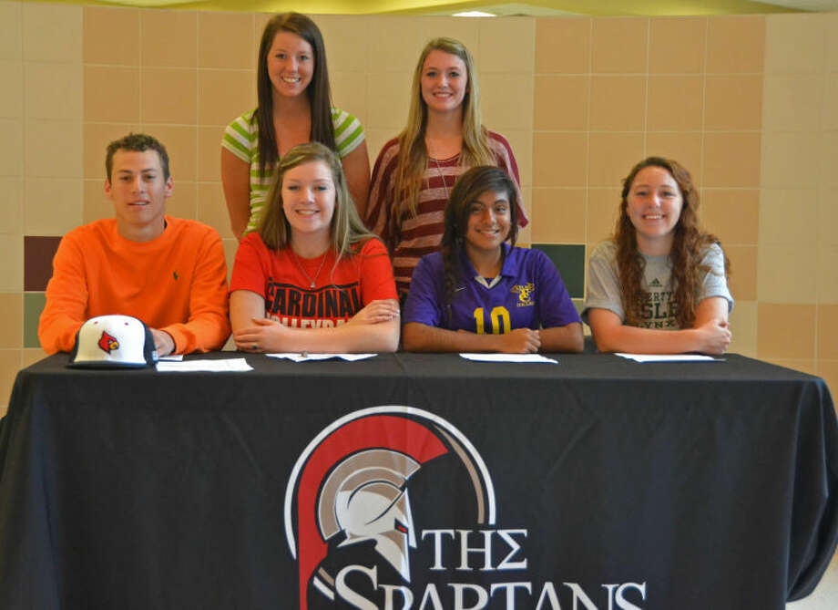 Porter High School hosted a National Signing Day ceremony on Feb. 6, 2013. Standing, from left, are Samantha Warren and Terina Harris. Seated, from left, are Kyle Porter, Victoria Hesson, Clara negrete and Cassidy Hopkins.