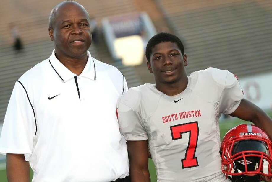 South Houston Head Coach C.L. Whittington with running back Byron Hodges, a senior on the Trojans' 2012 squad.