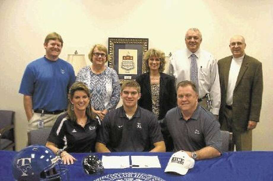 Taylor senior Robby Wells signed a football scholarship with Rice University, celebrating the achievement with (bottom row) mother Donna Wells, father Robert Wells, (top row) THS assistant coach Nate Shallenberger, 12th grade principal Pam Metcalf, counselor Nancy Gonzalez, principal David Kendler and head coach Flint Risien. / @WireImgId=2615115