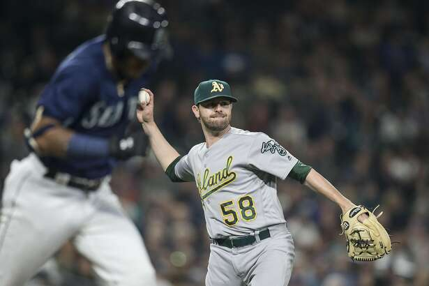 SEATTLE, WA - SEPTEMBER 30: Relief pitcher Zach Neal #58 of the Oakland Athletics throws to first for a put out after fielding a ball hit by Ketel Marte #4, left, of the Seattle Mariners during the fourth inning of game at Safeco Field on September 30, 2016 in Seattle, Washington. The Mariners won the game 5-1. (Photo by Stephen Brashear/Getty Images)