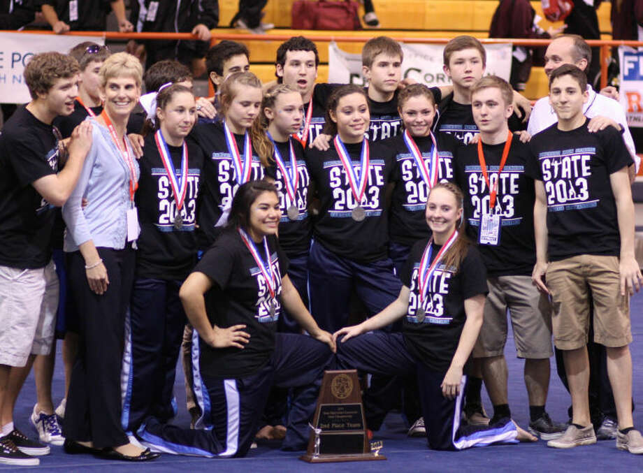 Kingwood's gymnastics teams pose for a picture after competing at the state tournament. On the front row, from left, are Jessica Esparza and Madison Maxey. On the second row, from left, Coach Brenda Osterman Ray, Haili Menard, Taylor Depriest, Morgan Settegast, Sydney McAndrews, Daniela Sandoval and Jon Bradshaw, Chris Fitt. On the third row, from left, are Austin Miles, Logan Andrepont, Ian George, Nick Pernik, Jon Rosen, Jake Pinkston, Austin Korous and head coach Kevin Reiland.