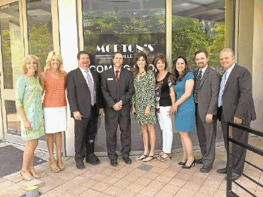 Past co-chair and 2013 VIP party chair Megan Alexander, 2013 co-chair Carrie Hyman, Tom Kohler of Morton's Grille, Kenny King of Freeman, 2013 co-chair Melissa Preston, past co-chair and 2013 VIP party chair Ruth Hiller, Nicki Keenan of Landry's Inc. Ron Slater of Morton's Grille and Mark Leach of Morton's Grille stand in front of Morton's Grille in The Woodland Waterway. The restaurant will host the VIP Party. / @WireImgId=2640613