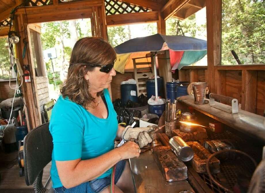 Nancy Adams learned to use an oxyacetylene torch as a teenager and now creates arts out of can in her business The Tin Armadillo.