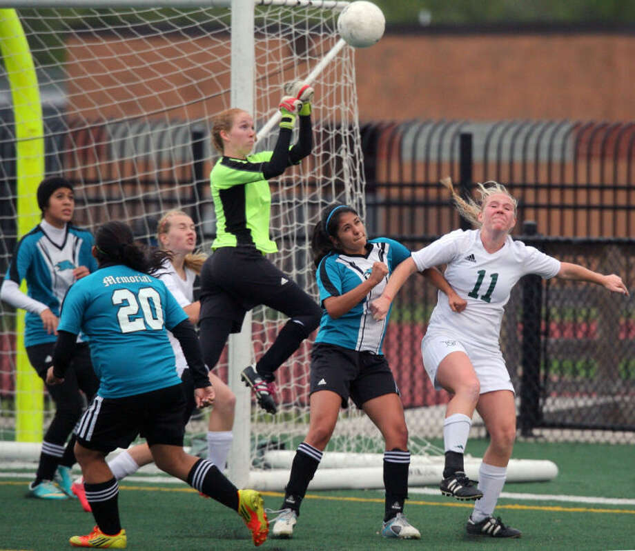 The Pasadena goalie punches the ball out of the goal area as they take on Clear falls in League City Thursday night.