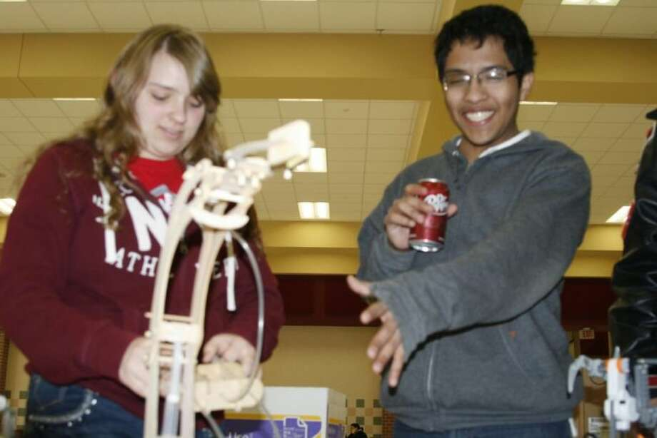 Two members of Porter High School's Technology Student Association chapter work with one of their robotic models after the regional competition hosted at Porter High School March 1 and 2.
