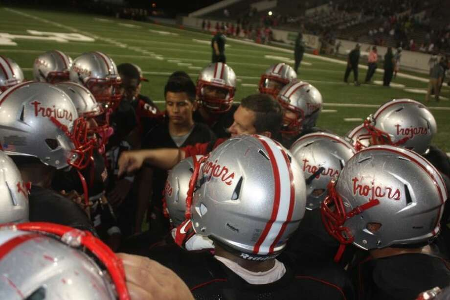 New South Houston head coach Dwayne Lane relishes his first victory huddle on the Newcomb Field turf Friday night. By holding Pasadena to seven points, it marked the first time South Houston has held an opponent to single digits in 19 contests or since the 2011 season.