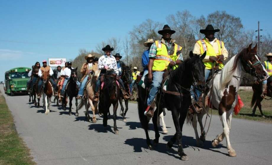 Members of the Pineywoods Trailriders Association passed through Cleveland on Feb. 19 on their way to the Houston Livestock Show and Rodeo.