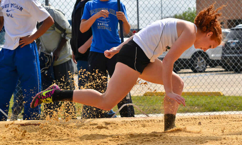 Kingwood Park's Rebecca Lewallen competes in the long jump at the District 19-4A Track and Field Championships held April 8, 2013, at Eagle Stadium in Mont Belvieu.