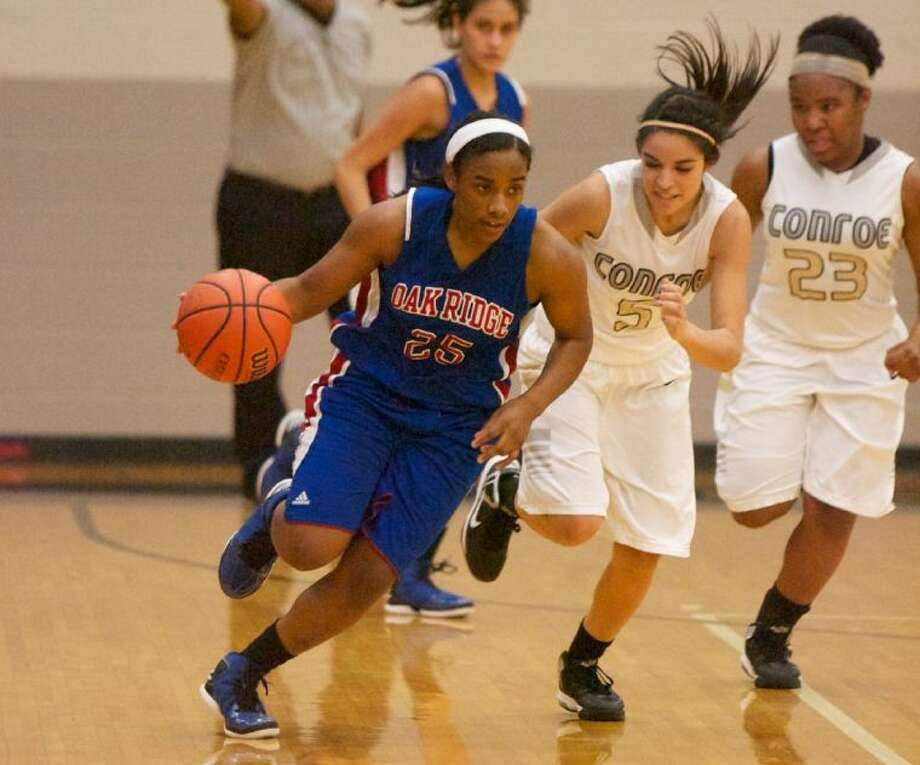 Oak Ridge's Raquel Kellow dribbles during Tuesday night's district game against Conroe.