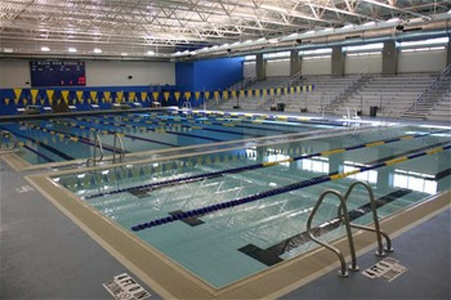 The new Klein High School natatorium is 10,800 square feet, and includes a regulation pool, diving boards, a separate warm-up area with three lanes, and bleachers with a capacity of 500 spectators.