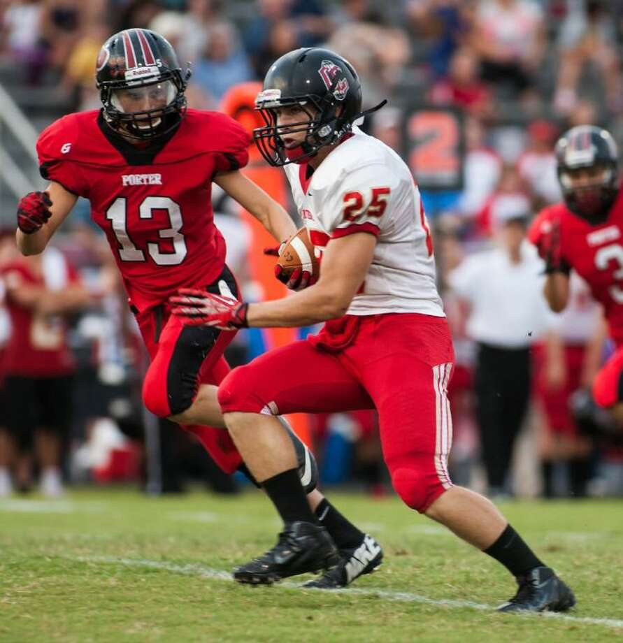 Porter's Brandon Purcell (13) gives chase to a Caney Creek runner earlier this season.