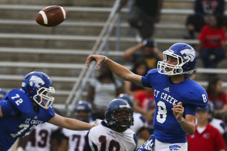Cy Creek's Ross Hargrove attempts a pass during the game against Cy Springs on Saturday at Pridgeon Stadium. To view or purchase this photo and others like it, go online to HCNPics.com. (Michael Minasi / HCN)