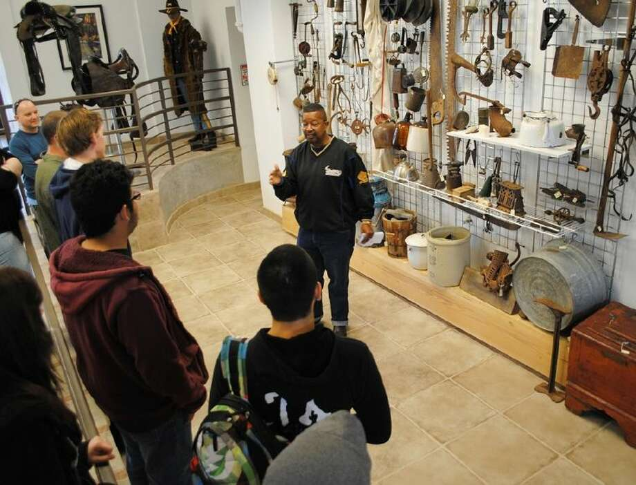 Buffalo Soldier Museum Founder Capt. Paul J. Matthews, center, speaks to a group of ACC students about the African American soldiers during a visit to the museum on February 15.