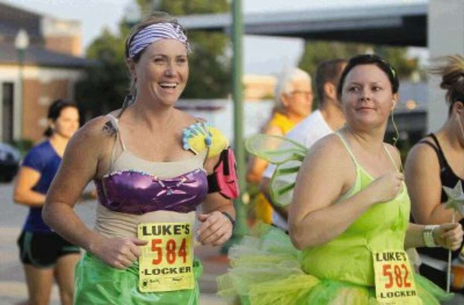 Some runners competed in the Woodforest Charity Run in colorful costumes for fun through downtown Conroe Saturday.